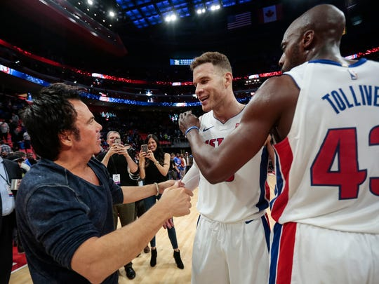 Pistons forward Blake Griffin (23) shakes hands with owner Tom Gores after defeating Grizzlies at Little Caesars Arena on Feb. 1, 2018.