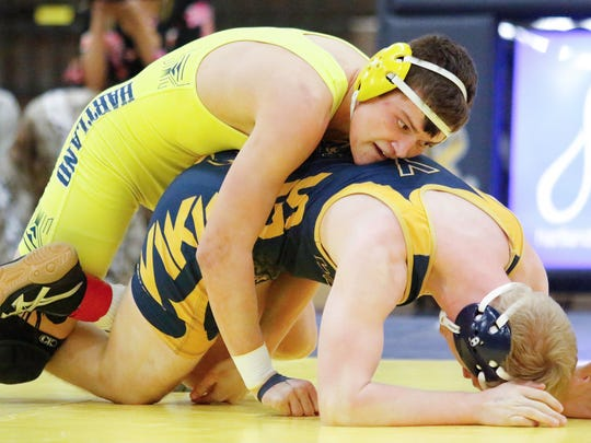 Hartland's Reece Potter (top) finished seventh at 160 pounds in the state Division 1 wrestling tournament after joining the team a month into the season.
