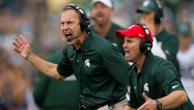 Michigan State and coach Mark Dantonio, left, shown here in a loss to Notre Dame last Saturday, will continue to play the Irish in the future but won't have a future series against Alabama, according to Spartans athletics director Mark Hollis.