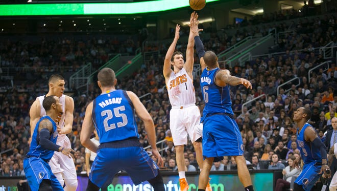 The Suns's Goran Dragic takes jump shot as the Mavericks' Tyson Chandler defends during the fourth quarter of the NBA game at the US Airways Center in Phoenix on Tuesday, Dec. 23, 2014.