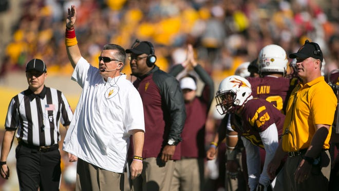 ASU head coach Todd Graham shouts during the first half of the PAC-12 college football game against Washington State at Sun Devil Stadium in Tempe on Nov. 22, 2014.