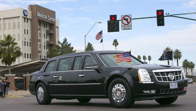 The Presidential limo containing President Barack Obama turns the corner onto Indian School Road in front of the Phoenix VA Medical Center after Obama spoke at nearby Central High School in Phoenix on home ownership, on Thursday January 8, 2015. Obama did not stop at the scandal ridden Phoenix VA.