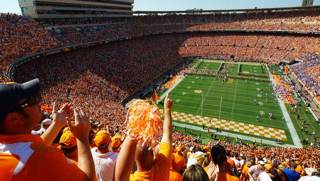 """Fans cheer as the Vols run thru the """"T"""" before  Tennessee plays Florida."""