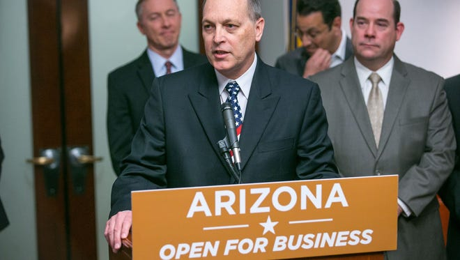 Senate President Andy Biggs discusses a $2 billion Mesa Apple command center at the Arizona State Capital in Phoenix on Monday, February 2, 2015.