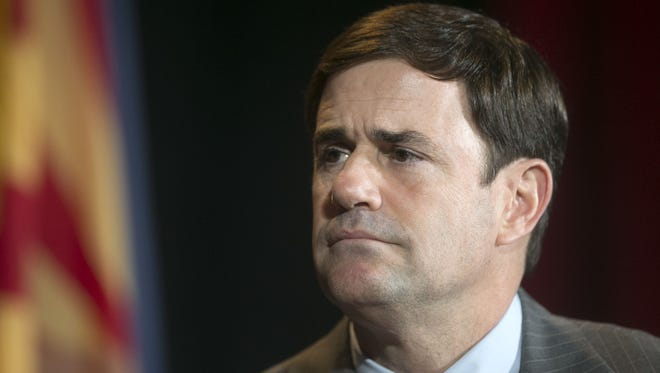 Businessman and Arizona State Treasurer Doug Ducey, a gubernatorial candidate for Arizona, looks on during the forum for Arizona gubernatorial candidates hosted by the Arizona Republic and The Arizona We Want Institute Candidate at the Phoenix Convention Center on Friday, June 6, 2014.
