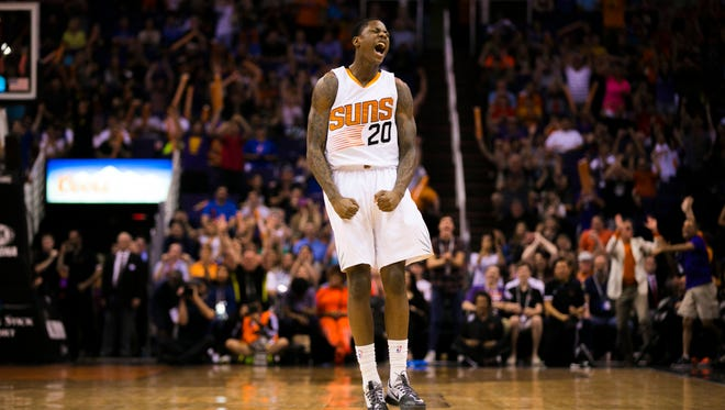 Suns' Archie Goodwin reacts after making a late three to give the Suns the lead over the Mavericks at US Airways in Phoenix, AZ on March 22, 2015.