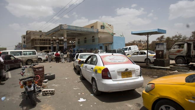 Cars line up amid fuel shortages in Sanaa, Yemen, on April 8, 2015. A state-run broadcaster in Iran is reporting that the Islamic republic has sent a navy destroyer and another vessel to waters near Yemen amid a Saudi-led airstrike campaign.