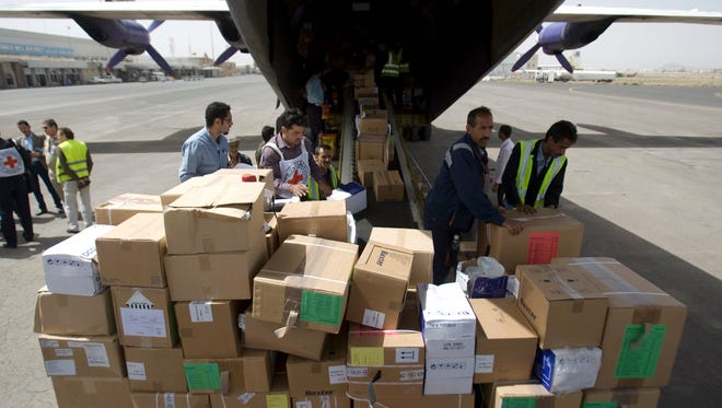 Aid workers unload humanitarian relief supplies for civilians affected by a Saudi-led airstrike campaign from a cargo shipment at the airport in Sanaa, Yemen, Friday, April 10, 2015. The Saudi-led coalition has been targeting Shiite rebels and their allies in Yemen in a campaign of airstrikes, now in its third week. (AP Photo/Hani Mohammed)