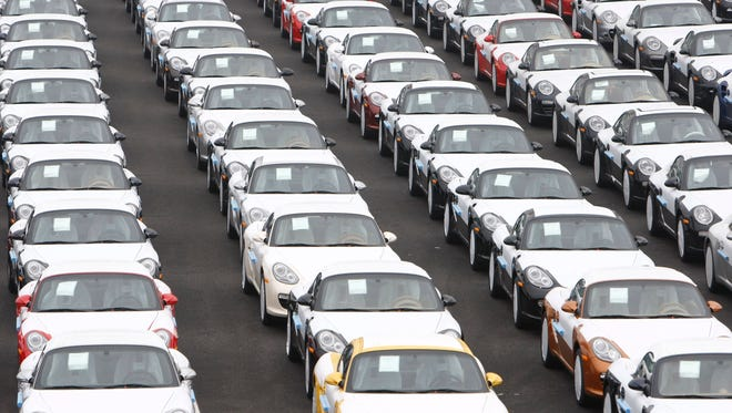 Auto sales could be highest in a decade, a website predicts. Here are Porsches lined up for export in a 2009 file photo