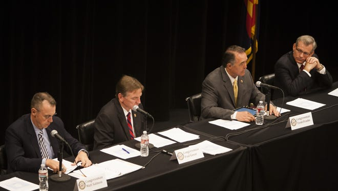 PNI0823-­met Congress field hearing 0944081913rs U.S. Representative Paul Gosar (cq) holds a congressional field hearing with the state's other congressional Republicans into IRS abuse and EPA overreach at the Mesa Arts Center on Thursday, August 22, 2013 in Mesa, Arizona. From left, Matt Salmon (cq), Paul Gosar (cq), Trent Franks (cq) and David Schweikert (cq) during the hearing. Stacie Scott/The Arizona Republic