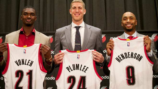 Christ School alum Mason Plumlee, middle, is a new member of the Portland Trail Blazers.