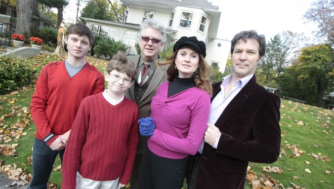 """The cast of Broadway's 2009 revival of the musical """"Ragtime"""" in front of the New Rochelle home on the Broadview Avenue hill where E.L. Doctorow wrote and set his 1975 novel  """"Ragtime."""" The actors, from left,  Bobby Steggert, Christopher Cox, Dan Manning, Christiane Noll and Ron Bohmer -- played a New Rochelle family. Historian Barbara Davis took them on a tour of New Rochelle sites featured in the novel and musical. Doctorow, a longtime New Rochelle resident, died in Los Angeles on Aug. 21, 2015."""