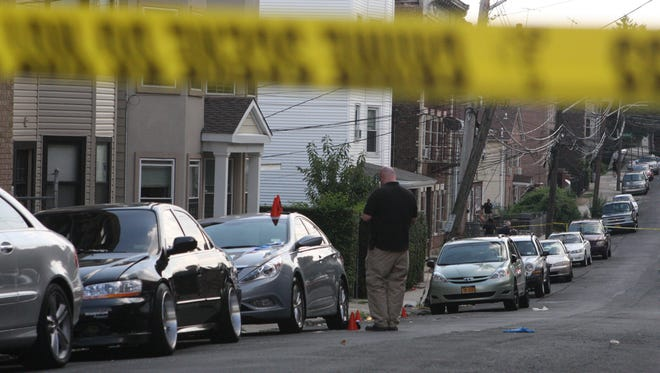 Police are shown in this file photo investigating at the scene of a fatal shooting Aug. 25 at Lake and Morningside avenues.