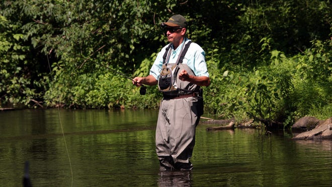 In this 2008 file photo, Steve Manning enjoys a sunny afternoon fly fishing for trout in the East Branch of the Croton River in Brewster.