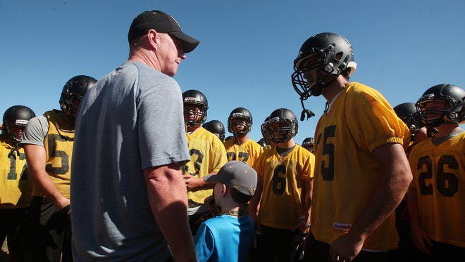 Hanover Park football head coach Gerry Moore addresses the team during practice in August.