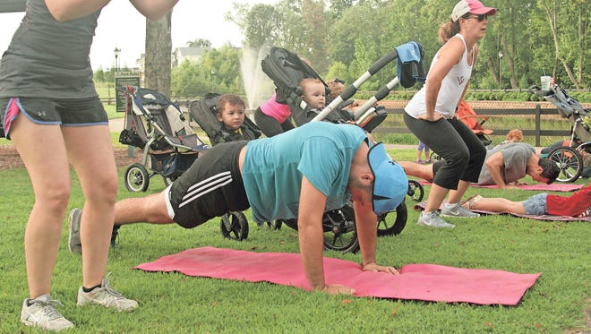 Moms and dads work out on a Saturday Morning during a Strong Mamas class