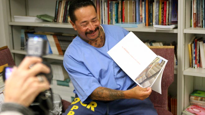 David Garcia is recorded reading a book to his grandchildren as part of The Messages Project at Salinas Valley State Prison.
