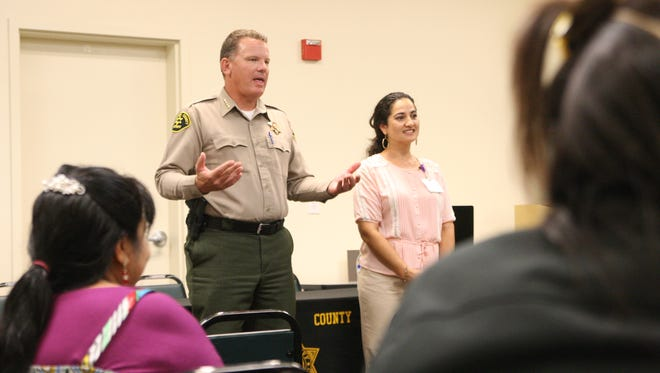 Monterey County Sheriff Steve Bernal speaks to residents at a Greenfield town hall.