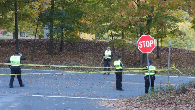 Police investigate a fatality on Route 22 in Bedford, Oct. 16, 2015.