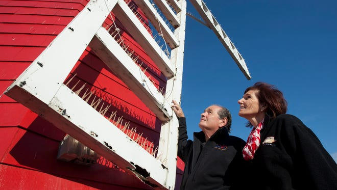 WindMill owners Steven Levine and his sister Rena Levine Levy look at the windmill vanes on the iconic Long Branch restaurant that date to 1963.