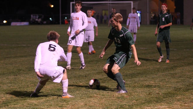 Oak Harbor's Nate Poiry creates enough space to take a peek in the postseason. Poiry was recognized first-team all-district.