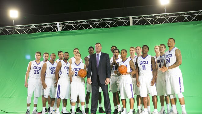 Grand Canyon University men's basketball coach Dan Majerle (center) and the team pose for a video shoot during the Grand Canyon University Men's Basketball Media Day at GCU Arena at Grand Canyon University in Phoenix on Wednesday, Sept. 23, 2015.