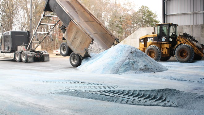 FILE -- A truck delivers a load of salt to the city of Clarksville at its new salt shed facility on Needmore Road.