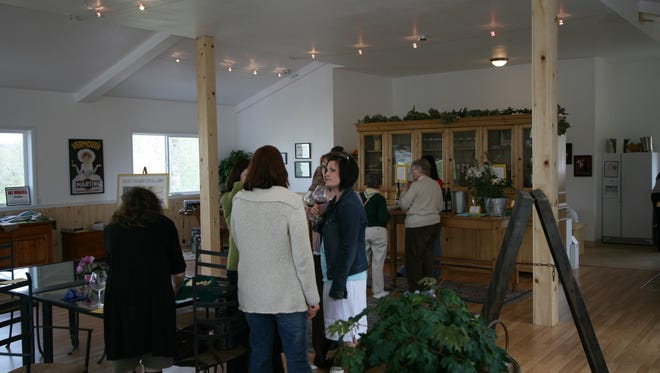 Visitors enjoy a sampling of the wines at the tasting room of Left Coast Cellars, 4225 N Pacific Highway in Rickreall.