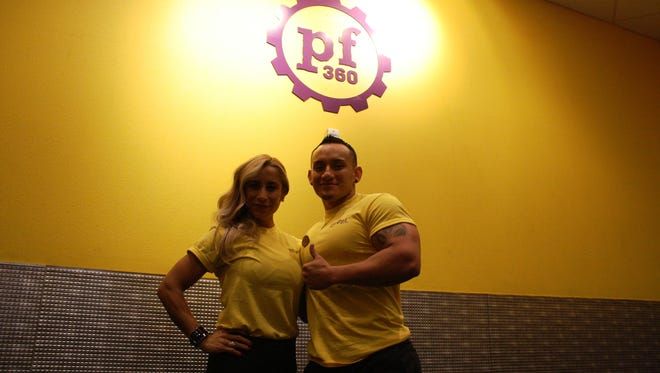 Nancy Diaz and Lorenzo Hernandez pose for a picture at the Planet Fitness located on Pebble Hills Boulevard in East El Paso Blvd.