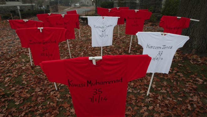 To commemorate the third anniversary of the Sandy Hook Elementary School shooting, Morristown's Church of the Redeemer placed shirts representing the names of New Jersey gun violence victims on their front lawn. They were also open for prayer between 8am-4pm to remember victims of gun violence. December 14, 2015, Morristown, NJ.
