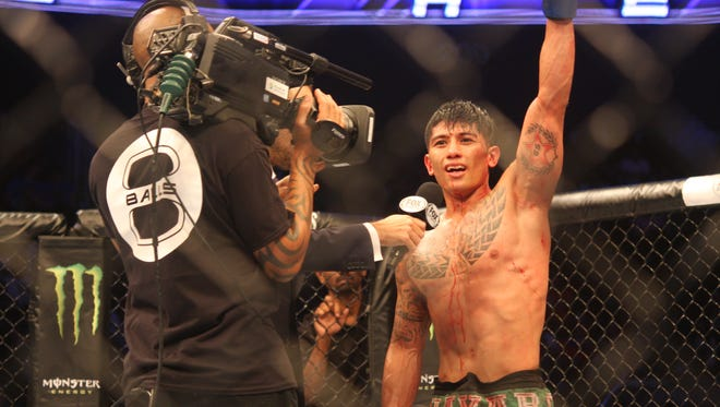In this file photo, Jon Delos Reyes celebrates his Ultimate Fighting Championship victory at UFC Fight Night 66 in Manila.
