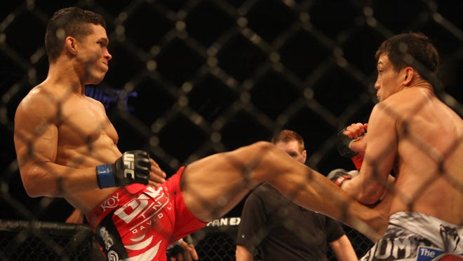 In this file photo, Jon Tuck kicks Tae Hyun Bang in their lightweight bout at UFC Fight Night 66 in Manila.