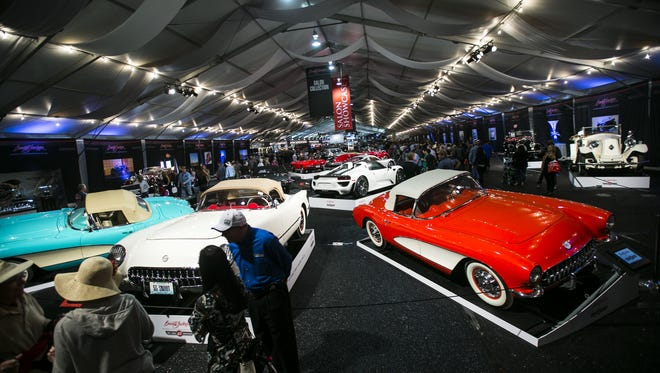 A 1955 Chevrolet Corvette (white) sits in front of auction attendees at the Barrett-Jackson collector-car auction in Scottsdale on Saturday, Jan. 23, 2016.