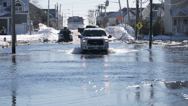 Roads in low lying areas of Manasquan are still flooded from the storm. Storm waters on East Main St. —January 24, 2016-Manasquan, NJ.-Staff photographer/Bob Bielk/Asbury Park Press