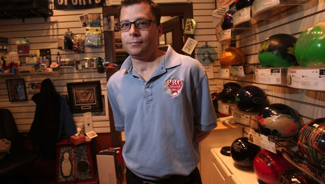 FILE PHOTO - This Dec. 19, 2013, photo shows Al Jones, owner of the Rockaway Lanes Pro Shop. Jones bowled professionally and had cystic fibrosis, surviving two double lung transplants. He died Wednesday.