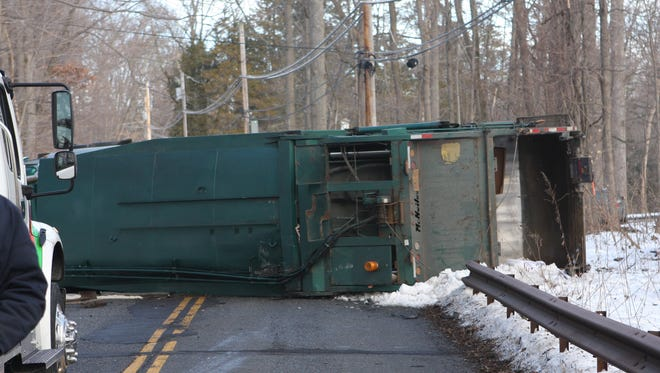 A garbage truck overturned on Shingle House Road in Millwood on Wednesday.
