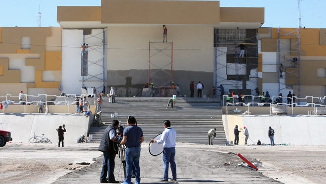 Crews on Thursday work on the altar that will be used when Pope Francis celebrates Mass on Feb. 17 in Juárez.