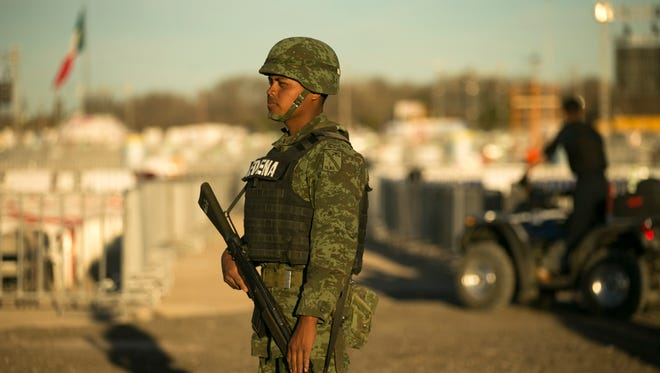 Mexican military stand guard at the fairgrounds in Juarez, Mexico, on Tuesday evening, Feb. 16, 2016.