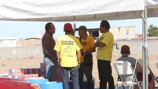 Coordinators rent spaces Tuesday in an empty lot along Avenida Tecnologica and Avenida Pedro Rosales de Leon in Juárez.