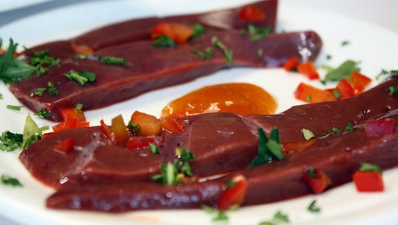 """Raw bison liver from """"The Fort."""""""
