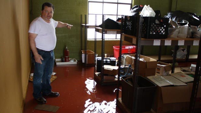 John Elford, who owns the building at 500 Airways Blvd., is frustrated about repeated flooding in the area.