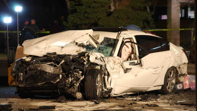 A Nissan Maxima was involved in a multi-car collision in Mount Vernon on Tuesday. NYPD officer were posted at the scene.