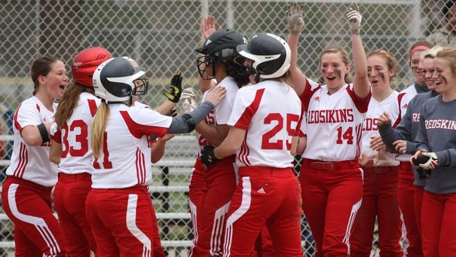 Port Clinton's Delayna Laurel is surrounded by teammates after a home run last season.
