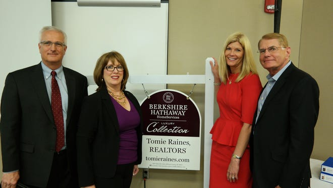 Tomie Raines Inc. has been acquired by Berkshire Hathaway. Pictured with the new logo are from left,  Steve Fase, CEO of Berkshire Hathaway Home Services Michigan; Susan Ireland, manager of Business Consulting at HSF Affiliates LLC; Debbie Barnett, president of Berkshire Hathaway HomeServices Tomie Raines Realtors; and Chairman Lane Barnett.
