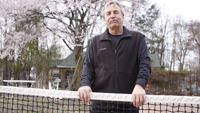 Ed Merritt stands on the original tennis court his grandfather built on Ehrhardt Road in Pearl River in 1931.