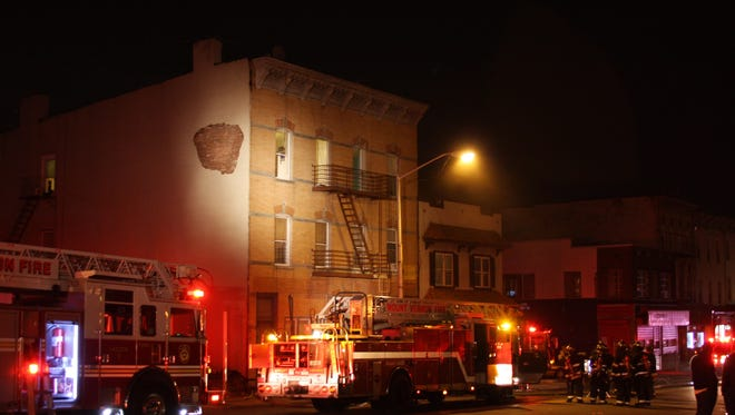 A two-alarm fire displaced between 14 and 18 people in an apartment building at 14 Mount Vernon Ave. on Wednesday night, officials said.