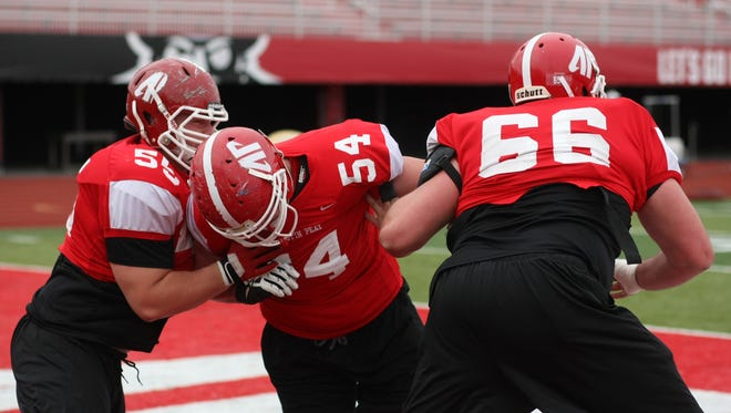 Members of Austin Peay's offensive line run through drills emphasizing foot spacing during APSU's spring practice.