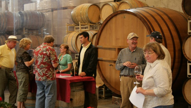 Guests sample wines at Illahe Vineyards during Memorial Day weekend in 2012. The winery will pair wine with s'mores and fondue in honor of Valentine's Day.