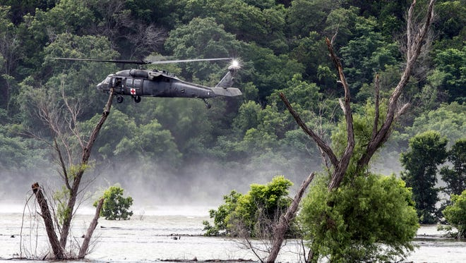 Army helicopters hover above Lake Belton on June 3, 2016, searching for four missing soldiers from the U.S Army's Fort Hood who were swept away in a low water crossing during training. Their bodies were recovered that night.