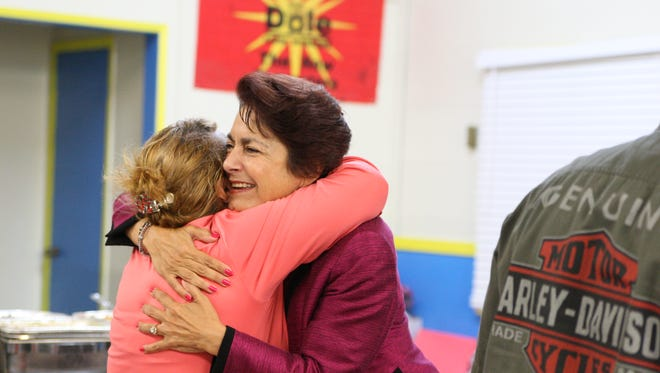 Anna Caballero hugs a supporter during her election night party.